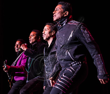 LOS ANGELES, CA - JULY 22:  (L-R) Tito Jackson, Jackie Jackson, Marlon Jackson and Jermaine Jackson perform at The Greek Theatre on July 22, 2012 in Los Angeles, California.  (Photo by Chelsea Lauren/WireImage)