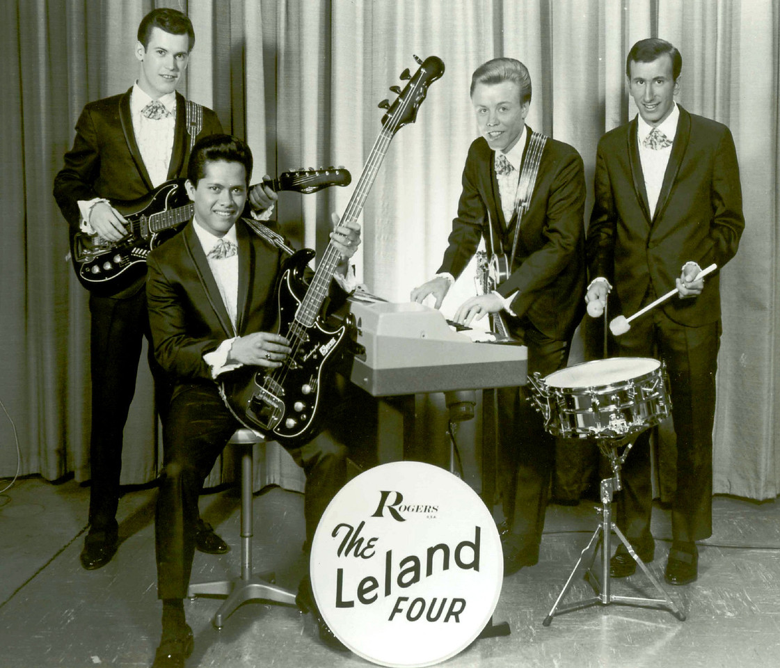 "<br> <font color=red><font size=3>band name<br><font color=white>The Leland Four<br> <br></font size=3><font size=2> <font color=red>submitted by<br> <font color=white>Rick Stock<br> <font color=red><br> who's in the picture<br> <font color=white>Rick Stock, Jet Kanani, Lee Henriksen, Spud Ivens. <font color=red><br> where was the band based<br> <font color=white></I>Portland, Oregon (1965 -1967) Las Vegas, Nevada (1967 - 1973) Reno, Nevada (1973 - 1978)<font color=red><br> years active<br> <font color=white>1965-78 <font color=red><br> musical influences<br> <font color=white>The Lettermen, The Beatles, Beach Boys, Bee Gees, The Association, Chicago, Blood Sweat & Tears, Eric Clapton, The Mamas & Papas, Harry Nilsson, The Four Seasons (and a whole bunch more…too numerous to mention)  <font color=red><br> notes<br> <font color=white> Leland (Lee) Henriksen, Jet Kanani, Spud Ivens and myself -  ""The Leland Four"" (formerly The Hawaiian Shadows 1961-65) left Hawaii bound for Portland, Oregon on April 19th 1965 and opened at the ""Turquoise Room"" a local night club. <br> <br>  The band played 8pm-2am weeknights and 8pm-4am weekends, long hours, but hey….it was Rock n Roll and great fun!!<br> <br> Spud had to leave the band temporarily and return to Hawaii, he still had a year left to serve in the US Army. Gary Weller replaced him until June 1966.<br> <br>    After a 3 month gig at the ""T-Room"" the band booked into ""Ricardo's"" in Redding, California for 2 months then on to ""Harvey's Wagon Wheel"" a casino at the south shore of Lake Tahoe, Nevada. This was our first exposure to Nevada cabaret style entertainment. After Tahoe we played a month at ""The Golden Casino"" in Reno, Nevada then off to Anchorage, Alaska for 3 months. <br> <br>   During this time the decision was made to change the direction of the group. We were basically a Rock n Roll band making a living playing dance gigs and had peaked financially. <br> <br>    Our priorities were changing. We were no longer the single, carefree rockers. Lee, Jet & Spud were married, by this time, and starting families.  We needed to increase our income somehow.<br> <br>   We realized that without the elusive ""hit"" record we would continue at the same pay scale. But we were too busy making a living and not able to spend enough time in the studio, so a hit record was not in the cards.   <br> <br> During our brief experience in the Nevada casinos we had made friends with some of the cabaret groups and discovered that the casino circuit was highly lucrative, so we knew what we had to do.<br> <br>    The band played a gig in Anchorage, Alaska for seven months.  During that time we morphed into a cabaret act, emerging in the spring of 1967 as a Nevada style show band, incorporating comedy skits, show tunes, rock n roll, country music, Jazz etc.  ""Variety"" was the key word.  The versatility of the band enabled us to play any venue.<br> <br>    The band doubled on several instruments making a four piece band sound more like seven or eight!<br> <br>    Jet played Bass guitar and Valve Trombone (at the same time!)   Spud played Drums and Trumpet (at the same time!) He also played Piano and sometimes Slide Trombone.   Lee played Keyboards and Cornet (at the same time!) when he wasn't playing Rhythm guitar or Accordion.   I couldn't chew gum and walk at the same time so I stayed with guitar. When the guys picked up the horns I usually played heavy on the 12-string to help fill out the rhythm section. I also played Banjo, but not at the same time!  <br> <br> The group returned to Nevada, but this time as a cabaret act.  Reno, Lake Tahoe, Carson City and Las Vegas became our stomping grounds! We had made the right move!<br> <br>    From 1967-1978 The Leland Four played in countless casinos, hotel chains, show clubs, Princess cruise ships (The Love Boat) and the Fair circuit. Traveling extensively throughout the USA, Canada & Mexico.<br> <br>    Over the years we were fortunate to perform with many stars.  At times as an opening act, or alternating shows with them.  <br> <br> Mick Box & Uriah Heep played a 2 night concert in Portland, Or. in the early '70's They stayed at the Ramada Inn where the Leland Four were playing in the cabaret lounge.  Mick & the guys hung out at the lounge after their concerts and once they found out I was English the party was on! We all stayed on the same floor of the hotel, partied all night!!  <br> <br>  In 1976 The Leland Four performed at a cast party in Liberace's honor... <br> <br>  Liberace was not only a great pianist and entertainer, he also had class.<br> <br>  As the show began he gathered his entourage and, leaving several hundred specially invited guests, sat front and center and watched the entire show, refusing to leave until it was over. He also allowed Spud to play his $25,000 piano for a comedy routine. Liberace then stayed behind after the room cleared for a photo opportunity with the group. <font color=red><br> brushes with fame<br> <font color=white>The Leland Four performed and/or associated with the following artists: Jimmy Dean, Larry Gatlin, Ted Neeley, Bob Bogle (Ventures) Liberace, Lionel Hampton, Debby Reynolds, Foster Brooks, Jerry Vale, Vic Damone, Frank Sinatra Jr. Xavier Cugat, Paul Revere & The Raiders, Sam Butera & the Witnesses, Freddy Fender, Lee Greenwood, Blood, Sweat & Tears, The Cascades, Red Skelton, England Dan & John Ford Coley, Uriah Heep, The Pointer Sisters, The Lockers, Hee-Haw (and a whole bunch more…too numerous to mention). <font color=red><br> where are they now<br>  <font color=white>Spud left the band in 1978 and lives in Los Angeles. He and his wife manage a home for the elderly. He performs as a single, entertaining in retirement and nursing homes in the Los Angeles area.  <br> <br>Lee, Jet & I stayed together adding two new members to the group. The name was changed to ""The Lelands""."