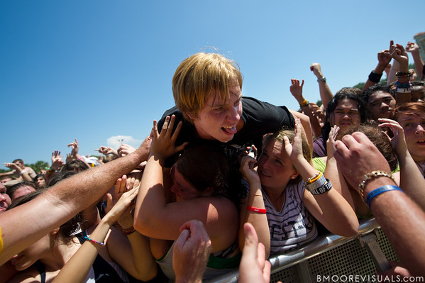 A fan crowdsurfs to the front of the crowd while The Red Jumpsuit Apparatus performs on May 28, 2011 during 97X Backyard BBQ at Vinoy Park in St. Petersburg, Florida
