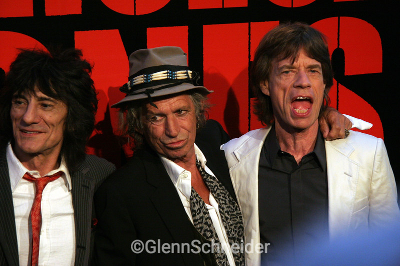 "Here is my recap of my 2008 Rolling Stones experience:<br /> GLENN & THE ROLLING STONES March 2008 <br /> <br />    If you look up COOL in the dictionary, you would find a photo of KEITH RICHARDS. If you looked up FANATIC in the dictionary, you would see a photo of a shirtless Jets fan painted green at a icy-cold game in the snow and you would also see a photo of ME in my Rolling Stones shirt. Yes, if you know me, Glenn Schneider, you know I am a Rolling Stones fanatic. <br /> <br />    This is a brief recap of my Rolling Stones experience last month, which actually had its start over a year ago. Let me explain: <br /> <br />    In the fall of 2006, the Rolling Stones played two nights in the Beacon Theater in NYC. One night was a fundraiser/birthday party for Bill Clinton and both nights were to be filmed for Martin Scorcese's ""Shine A Light"" Rolling Stones movie. I was lucky enough to score a ticket to both nights, with the help of my Stones fan friends. <br /> <br />    Last summer, Aug 2007, I found the Shine A Light movie trailer on the internet & I was excited to see that it was a Paramount movie, since I often work press interviews for Paramount movies. I mentioned this to the woman who books me to keep it on her radar. <br /> <br />    Around early March 2008, as the movie release date was approaching (April 4, 2008) I figured we were not going to get the interview job. I emailed my contact person reminding her that the movie was due soon. I wrote,: ""I guess we're not going to get to do the Stones job?"" <br /> She wrote back: ""Glenn, don't poop yourself, but we got it & you are on it!"" <br /> I couldn't believe it! And I was very,VERY excited. <br /> <br /> Rumors were already being posted on the internet of where it was, and how my fanatic friends were scheming to get in or just hang out in the area. I had the golden job! I was going to get paid to do something I would normally offer to pay for! How awesome is this! <br /> <br /> I was nervous that the day would be canceled or the day would never come. I didn't tell too many people about it until a day or 2 before it was going to happen. By then, I was bursting at the seams with excitement. <br /> <br /> Press conference <br /> I arrived early for my 10AM call for the press conference. A small crew was building the foam core backdrop in a large room on the 4th floor at the Palace Hotel in Manhattan. Soon we loaded in all the gear and setup. I was one of the 3 camera operators for the satellite feed. It was very exciting to be at the press conference, to see the band close up. Plus I knew how many fan friends were dying to be here & I was in and I was getting paid! <br /> <br /> The press conference had Mick, Keith, Ronnie, Charlie & Martin Scorsese answering questions for a room of about 200. There was a bunch of press video cameras in the back. I was part of a 3 camera crew, taping the event which would later be the satellite feed. I was the side camera getting a 2 shot. The Stones were in & out quite fast, less than 30 minutes.  It was very cool, but way too quick. I was still buzzing with excitement with the wrap and thinking about the Red Carpet event that was happening in a few hours. When the set crew was breaking down the foam core background, I asked if I could have it. It was already cut up, but still it would be awesome to have. It was very heavy, but I carried it to my car, parked on a NYC street a few blocks away. It is 9 feet X 18 feet !!! <br /> <br /> The Red carpet <br /> At the Zeigfeld Theater, the Shine A Light movie was premiering and the Stones were going to attend. It was actually a black carpet under a huge tent, with tons of press coverage. It was crowded kaos. The still photographers were lined up shoulder to shoulder for about 100 feet, and then there was the video/TV section. Behind the photographers, was another line of photographers on step stools. <br /> <br />    Many celebs were attending, but some were slipping by behind us, not wanting to be noticed, like Val Kilmer. I noticed Lisa Fischer, the Stones backup singer. I said hello, shook her hand, and told her she should be on the other side! She agreed & turned around. She then hung out with the other backup crew and greeted the Stones as they arrived. I also saw Albert Maysles. He was also on the wrong side. I said hi & told him to go around to the red Carpet. His guest was my friend Michelle. She agreed & walked with Albert on the Red Carpet. Albert worked on some of the behind the scenes video for this movie & he was director of the 1969 Gimme Shelter movie. <br /> After the red carpet, I went out to dinner with my friends that were across the street. (Lynn, Gail, Bob & L'ren) <br /> <br /> Palace Hotel interviews <br /> Now the next day, Monday, and this day was even better! We were working on interviews with the band for E!, Extra, Access Hollywood & CBS Morning News. Mick was in one room, Ronnie & Charlie side by side in one room, & Keith in another. I requested Keith's room and got it! Each of the 4 interviews were about 7 minutes long.  I was excited and nervous. I had a few secs to talk to him between interviews, telling him that I was at both of these Beacon shows, what a big fan I was, showing him my tat. His reply was "" Oh, so you're hooked"" <br /> He was very pleasant, funny, and unique in his normal keith way, coming up with answers only he could drum up. <br /> <br /> We began our wrap, but the band was still doing radio interviews in different rooms on the same floor. Ronnie walked right by me in the hall, passing the room he was supposed to go in, and they asked me where the room they were supposed to go in was located. I was kind of speechless, and just pointed to the door, 2 doors down. I saw Mick jump on the elevator with his security guy. We had to stop working, (pushing cases) for Mick to get by to the elevator. <br /> <br /> It was a surreal experience for such a super STONES fan, like myself. These are two days I will never forget, <br /> It only compares to the day I worked with Mick doing interviews in 2004 for the Alfie movie. (that is the only reason I did not request Mick's room, since I had worked with him previously). And I am sure you have seen the wide-eyed photo of me from that exciting day. <br /> <br /> I have since seen the movie twice in IMAX. It is a great concert movie, much different than their past concert DVD releases. This one makes you feel like you are actually there. And the audio mix is fantastic. I highly recommend seeing it, and if you miss it in the theaters, it will be out on DVD September 23rd, 2008."