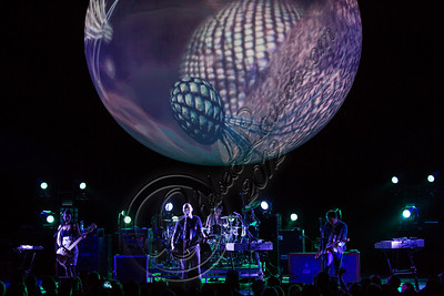 UNIVERSAL CITY, CA - OCTOBER 14:  (L-R) Bassist Nicole Fiorentino, vocalist Billy Corgan, drummer Mike Byrne and guitarist Jeff Schroeder of The Smashing Pumpkins perform at Gibson Amphitheatre on October 14, 2012 in Universal City, California.  (Photo by Chelsea Lauren/WireImage)