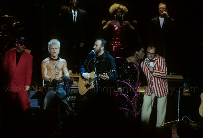 "WHO_lp_1013 The Who perform their classic Rock Opera ""Tommy"" at the Universal Ampitheater in Los Angeles, CA with an all-star guest cast. Pictured l-r are Elton John ""Pinball Wizard"", Billy Idol ""Cousin Kevin"", Pete Townshend the composer of ""Tommy"", Patti LaBelle ""The Acid Queen"" and Phil Collins ""Uncle Ernie."" Photo ©Laurie Paladino 1989"
