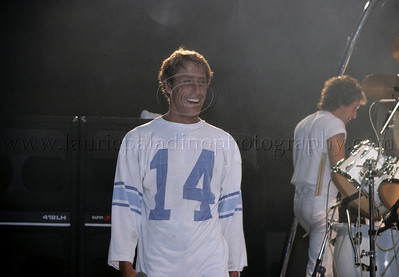 WHO_lp_1028 Roger Daltrey of The Who smiles during The Who's performance at the Capitol Theater in Passaic New Jersey. Also pictured is drummer Kenney Jones. Photo ©Laurie Paladino 1982