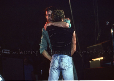 WHO_lp_1027 Pete Townshend and lead singer Roger Daltrey of The Who share a hug at the end of The Who's live concert performance in 1982 Photo ©Laurie Paladino 1982