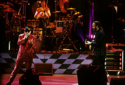 "Guest vocalist Elton John  performs The Who classic ""Pinball Wizard"" at The Who's performance of their Rock Opera ""Tommy"" Universal Ampitheatre 08/24/1989. Pictured are Elton John, percussionist  Jodi Linscott and Pete Townshend of The Who."