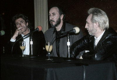 "WHO_lp_1038 The Who hold a press conference at Radio City Music Hall, New York City, April 1989 to announce their upcoming performance of their classic Rock Opera ""Tommy"" Pictured l-r: Roger Daltrey,  Pete Townshend, John Entwistle"
