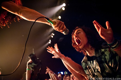 A fan sings along with The Word Alive during their performance on November 26, 2010 at The Ritz in Ybor City, Tampa, Florida