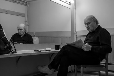 Tom Paxton reading the NY Times book review section in the green room at Music Hall in Tarrytown, NY.