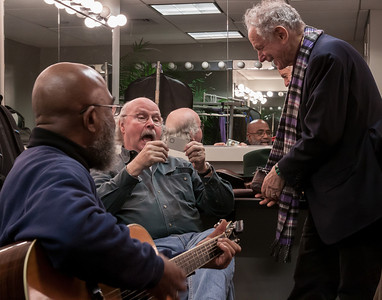 Josh White Jr., Tom Paxton and David Amram getting a kick out something on David's phone.  Green room, Symphony Space, NYC.