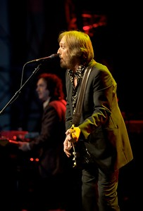 Mike Campbell and Tom Petty perform