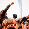 Kevin Drew of Broken Social Scene enjoys a relaxing crowd surf