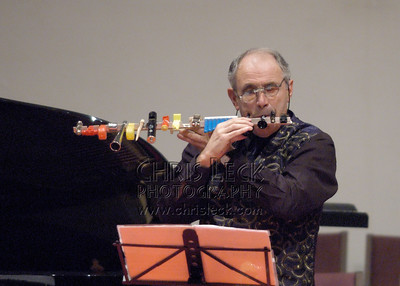 While some flutists are content to learn a few cross-fingerings, Mr. Wye demonstrates crossed-arm technique.