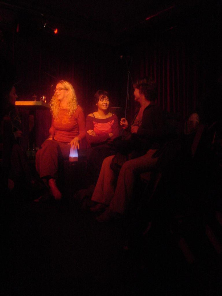 Girls sitting on stage in the light