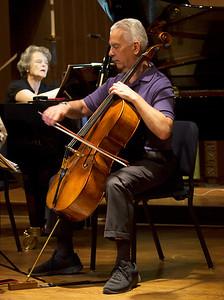 Norman Fischer plays while Jeanne Kierman Fischer studies the score.