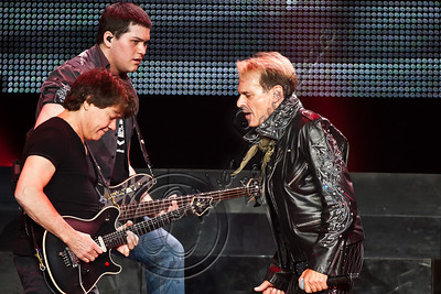 LOS ANGELES, CA - JUNE 09:  (L-R) Guitarist Eddie Van Halen, bassist Wolfgang Van Halen and vocalist David Lee Roth of Van Halen perform at Staples Center on June 9, 2012 in Los Angeles, California.  (Photo by Chelsea Lauren/WireImage)