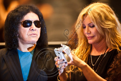 LOS ANGELES, CA - JUNE 09:  Musician Gene Simmons (L) and Shannon Tweed attend Van Halen in concert at Staples Center on June 9, 2012 in Los Angeles, California.  (Photo by Chelsea Lauren/WireImage)