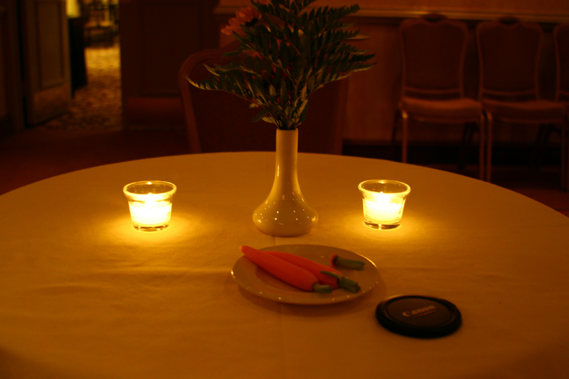 I thought the yellowish look to the picture added romanticism to it.  With the candles, carrots, and canon lens cap.