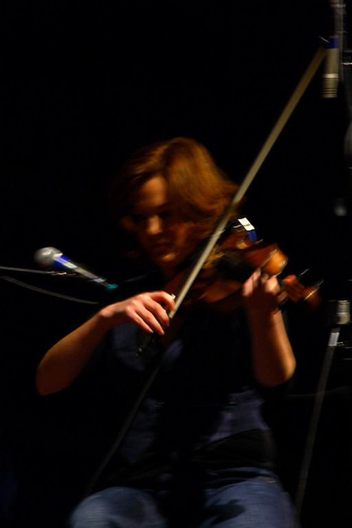 Dina playing Violin or the Viola.   I will say Viola cause it isn't that common to play that instrument.