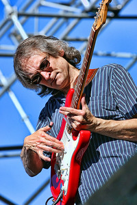 Sonny Landreth  Watch and listen on Youtube: http://www.youtube.com/watch?v=4oNFRWXDSA8&feature=related