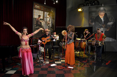 Belly Dancer and Freddy Clarke's Wobbly World at Loudville Recording Studio, Sausalito, CA. Recording and party. Oct. 26, 2012.  MEMBERS -  - Fely Tchaco, Ivory Coast (3rd on right) 	French and Guoro Vocals  - Georges Lammam, Lebanon 	Arabic Vocals / Violin  - Erick Barberia, Cuba 	Bata / Yoruba and Spanish Vocals   - Echae Kang, Korea (2th on left)   Violin   - Vassil Bebelekov, Bulgaria 	Gaida   - Scott Thompson, US 	Bass   - David Tucker, US 	Drums   - Freddy Clarke, Menlo Park (4th on right) 	Guitar / Vocals