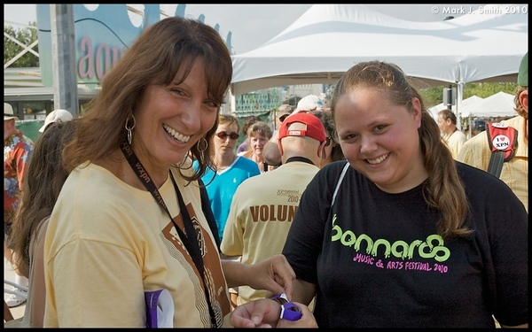 Volunteer Dr. Lori Cerretti from Norristown attaches Member badge to Lauren Spier from Willow Grove