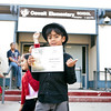 Xander showing off his award.