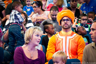 """One of many parents (and children) dressed as characters from Yo Gabba Gabba! awaits the start of the """"There's A Party In My City"""" show at St. Pete Times Forum on October 30, 2010 in Tampa, Florida"""