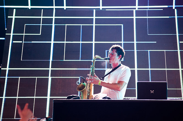 Dominic Lalli of Big Gigantic plays saxiphone at the Hilltop Arena