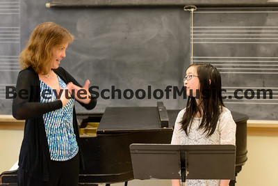 Bellevue School of Music flute student Jasmine receiving comments