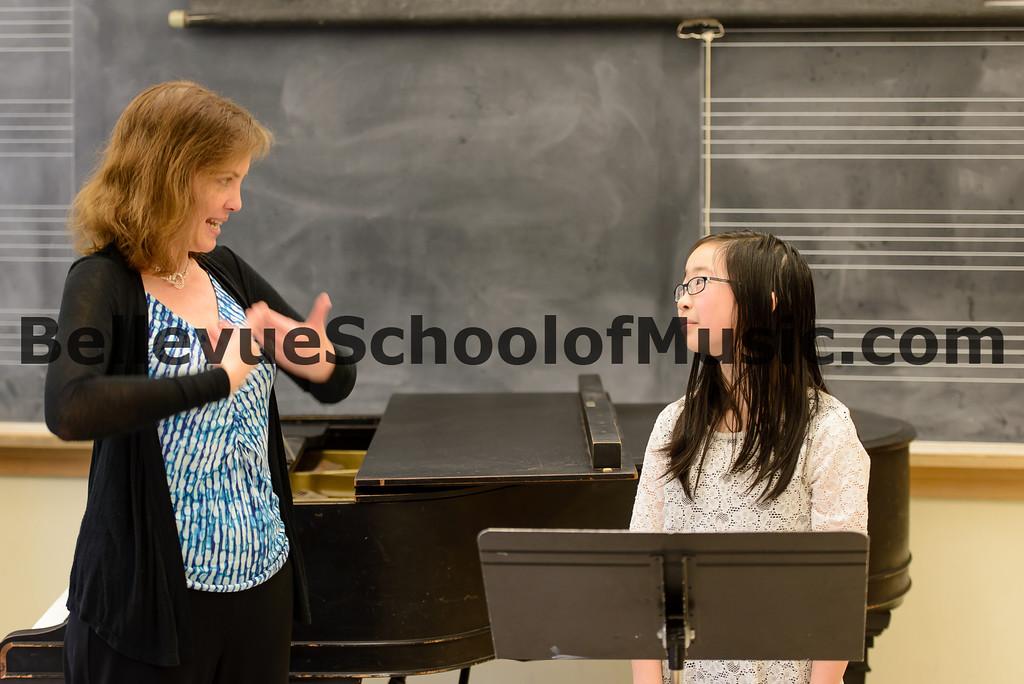 Bellevue School of Music flute student Jasmine receiving comments