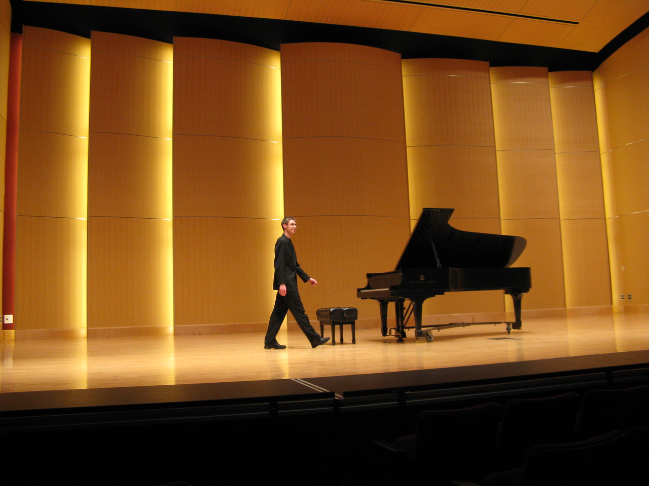 Kevin entering the stage in the Concert Hall in the Music Building at Central Washington University.