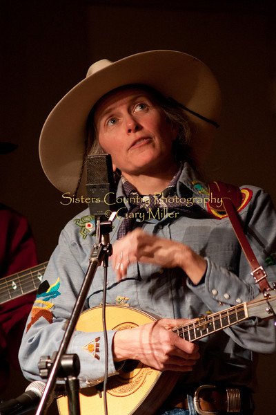 """Hey up there! Can I have my words back please?"" -  Lynn Woodward of The Anvil Blasters performs at the Hoedown for Hunger benefit concert for the homeless in Bend, OR. November 2009. Gary Miller - Sisters Country Photography"