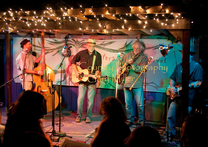 The Saturday late night after hours jam at Angeline's Cafe. Here Dennis McGregor, Peter Heithoff and Patrick ??? jam with Peter Rowan as the crowd of mostly local's carries the Festival forward to the wee hours. Photo by Gary Miller