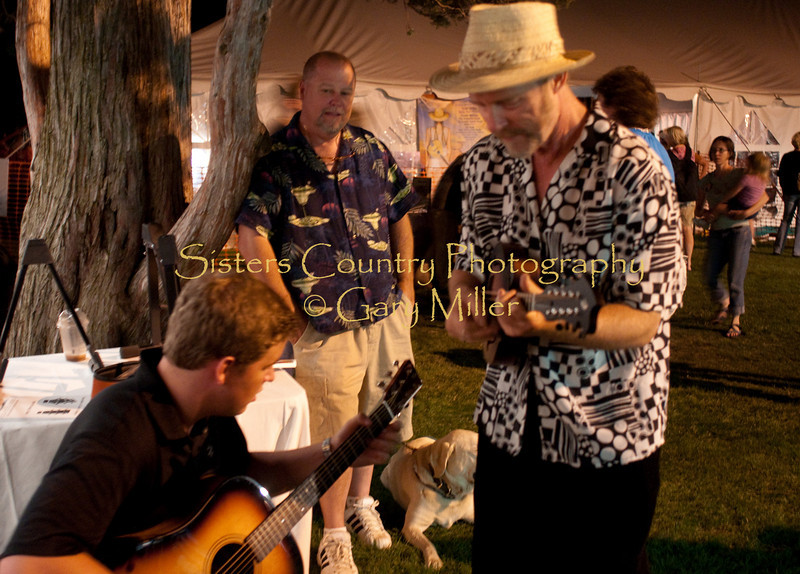 Americana Program graduate Austin Erlandson trades licks on Salt Creek with 'the master' Joe Craven at the Breedlove Booth as his Dad Del looks on. Austin has been accepted to the Berlklee School of Music which was his post festival destination.