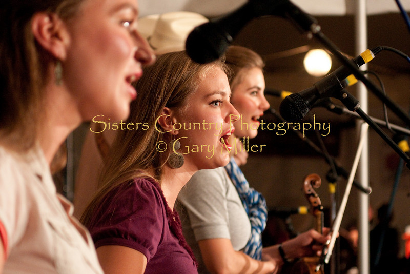 The Quebe Sisters Band rocked the deck of Bronco Billy's venue Saturday night of Sisters Folk Festival 2009 with their extremely tight 3 part harmonies with a western swing approach. The band features 4 fiddle champion musicians, truly an outstanding group. Photo by Gary Miller