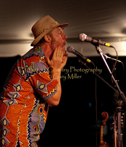 Poppin' a little Cheek. Joe Craven with The Alison Brown Quartet at the 2009 Sisters Folk Festival. Photo Credit: Gary Miller