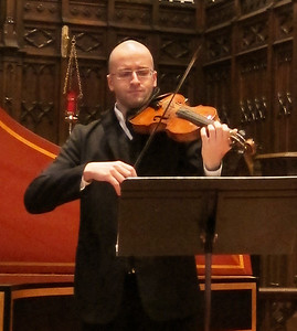 "Violinist Joan Plana of Concitato performing ""The Fantastical Style of 17th Century Italy"" at the Midtown Concert series in Manhattan, February 1, 2012."