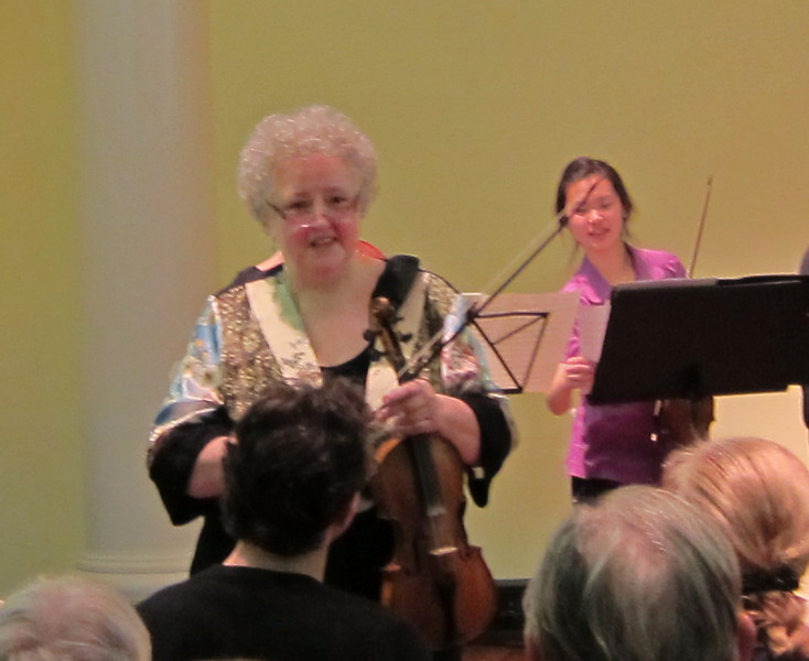 Monica Huggett pauses to give the audience insights into The Evolution of the Concerto Grosso, performed by her and the Juilliard415 ensemble in Manhattan's Abigail Adams Smith Auditorium on February 24, 2012.