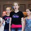 "The Crescendo Theater Company in Leominster MA has a summer program for kids which is in its second year. On Wednesday they were practicing for their show ""School House Rock"" in the auditorium at City Hall. Isabella Binici, 11, up front, sings the song "" A Noun is a Person, Place, or Thing"" with fellow performers. The kids will perform the show on Aug. 1 & 2, 2014 at City Hall and the show will be free to all. SENTINEL & ENTERPRISE/JOHN LOVE"