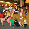 """The Crescendo Theater Company in Leominster MA has a summer program for kids which is in its second year. On Wednesday they were practicing for their show """"School House Rock"""" in the auditorium at City Hall. Director Kelly Bubello goes over some choreography with the kids during their practice. The kids will perform the show on Aug. 1 & 2, 2014 at City Hall and the show will be free to all. SENTINEL & ENTERPRISE/JOHN LOVE"""