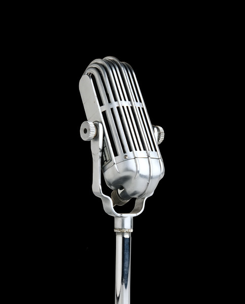 Vintage microphone isolated on black background