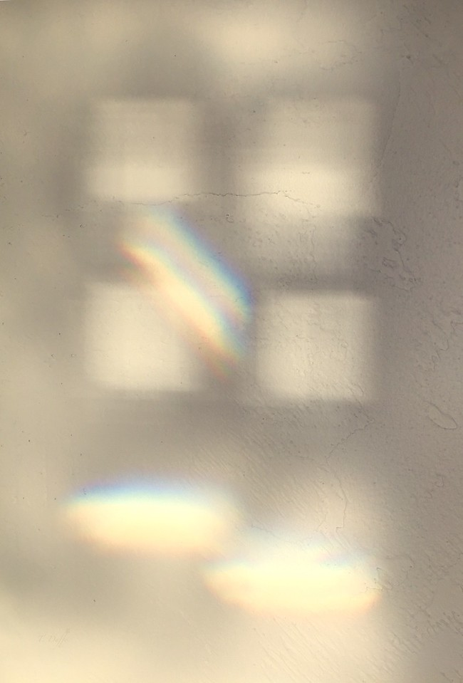 Later afternoon inspiration on the wall. The sunlight was refracted through an ornate glass door onto a textured, plaster wall. The best camera is the one you have with you.