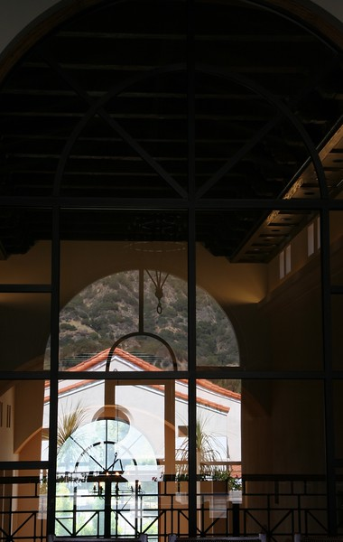 Compounding reflections in the great meeting room in the library, simultaneously visualizing the lofty interior of the library and the facade of Albertus Magnus Hall across the academic quad.
