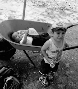 """Baby Stroller"", Road to Chetumal (after Hurricane Dean, class V hurricane), Mexico 2007  photograph by: Elizabeth Christopher © 2007"