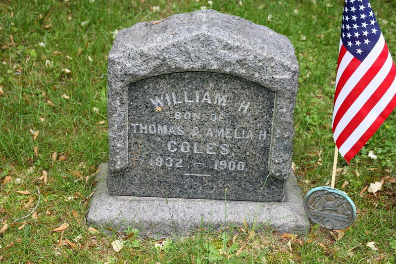 William H Coles (1832-1900), son of Thomas and Amelia Hewlett Coles; The flag marker is that of a volunteer firefighter