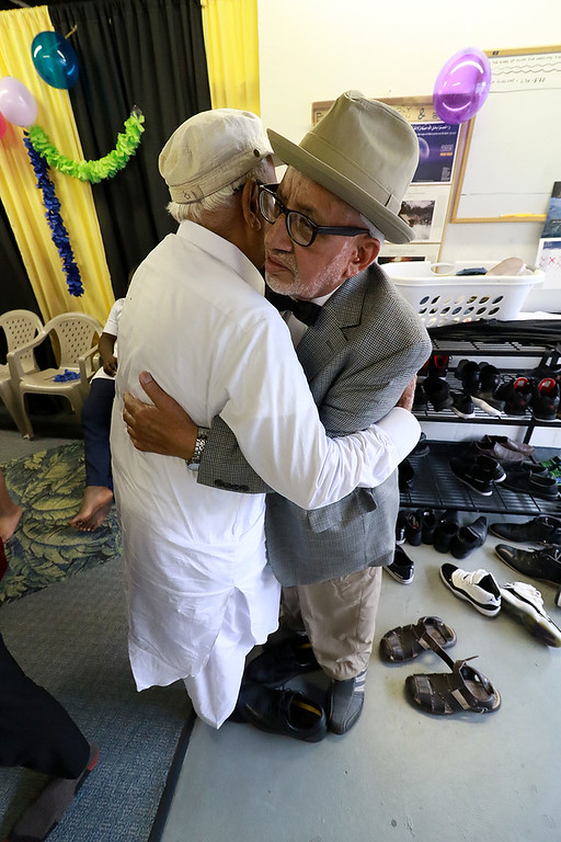 """. The Muslim holiday of Eid Al-Adha, also called the \""""Festival of Sacrifice\"""", was celebrated at Masjid Bait-ul-Zikr mosque in Fitchburg on Wednesday morning. Everyone greeted each other with hugs after the ceremony. SENTINEL & ENTERPRISE/JOHN LOVE"""
