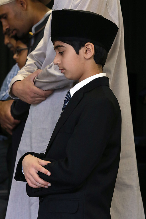 """. The Muslim holiday of Eid Al-Adha, also called the \""""Festival of Sacrifice\"""", was celebrated at Masjid Bait-ul-Zikr mosque in Fitchburg on Wednesday morning. Worshiper Kazim Mehmud prays during the ceremony at the mosque. SENTINEL & ENTERPRISE/JOHN LOVE"""