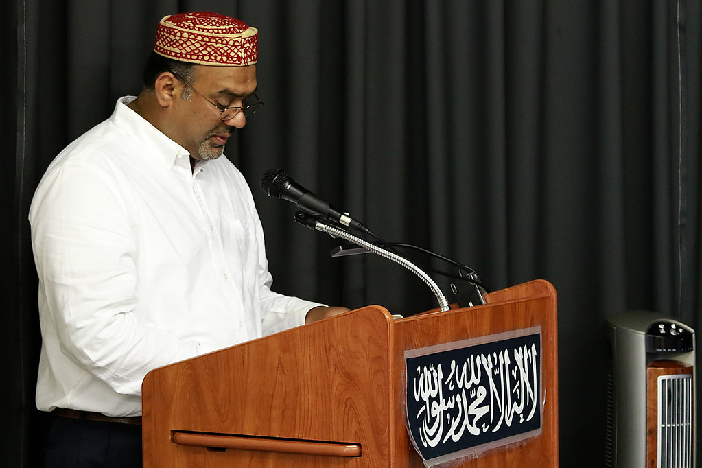 """. The Muslim holiday of Eid Al-Adha, also called the \""""Festival of Sacrifice\"""", was celebrated at Masjid Bait-ul-Zikr mosque in Fitchburg on Wednesday morning. Masood Ashraf gives a sermon during the ceremony at the mosque. SENTINEL & ENTERPRISE/JOHN LOVE"""