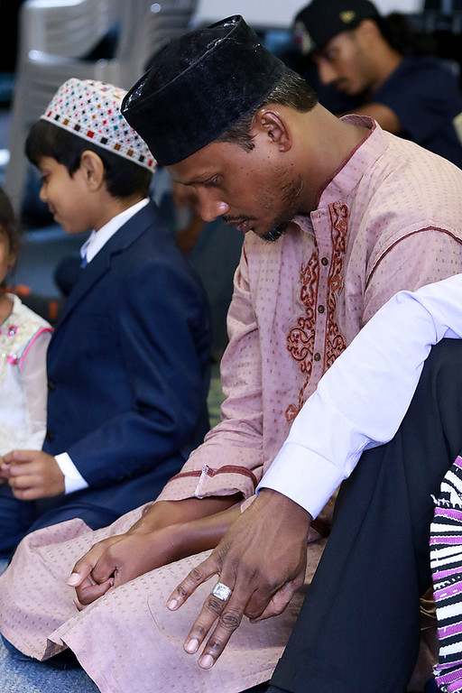 """. The Muslim holiday of Eid Al-Adha, also called the \""""Festival of Sacrifice\"""", was celebrated at Masjid Bait-ul-Zikr mosque in Fitchburg on Wednesday morning. Worshiper Mohiuddin Ovee prays during the ceremony at the mosque. SENTINEL & ENTERPRISE/JOHN LOVE"""
