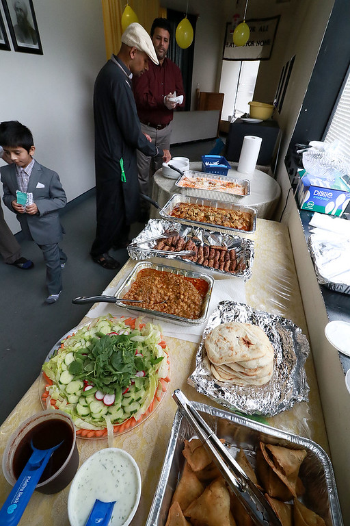 """. The Muslim holiday of Eid Al-Adha, also called the \""""Festival of Sacrifice\"""", was celebrated at Masjid Bait-ul-Zikr mosque in Fitchburg on Wednesday morning. They put out a small feast after the prayer. SENTINEL & ENTERPRISE/JOHN LOVE"""